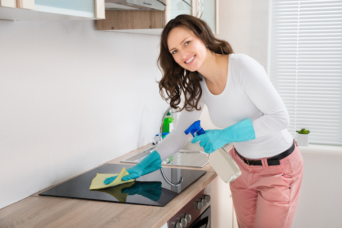 Woman Cleaning Induction Hob