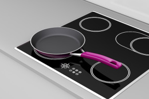 Frying pan at the induction cooktop, 3d rendered image